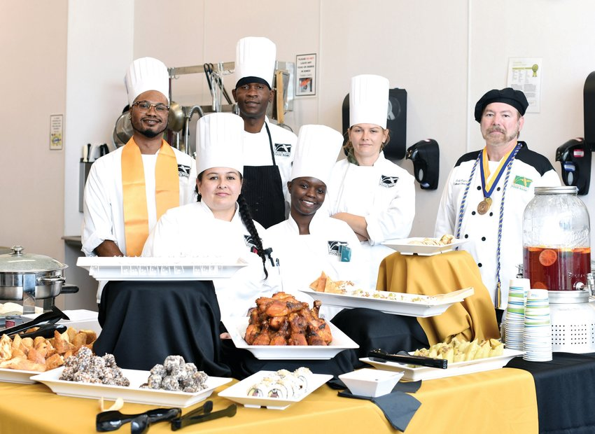 Chef Leslie Moyers, right, with recent graduates of Treasure Coast Food Bank's Culinary Training Academy.