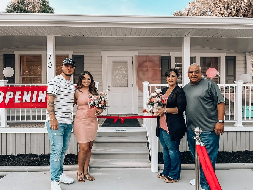 From left to right:  : Taylor Jordan, Giovana Maldonado, Nancy Maldonado, and Steve Maldonado. The owners of All About Me Beauty Bar    and their family celebrate their grand opening.
