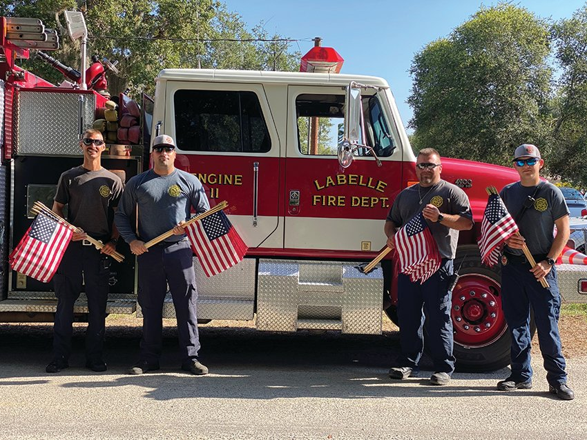 LaBele Fire Department helped place flags.