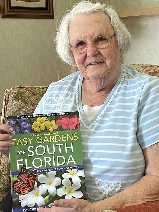 Ann Bowling with the book given as a loving tribute to her, Easy Gardens for South Florida.