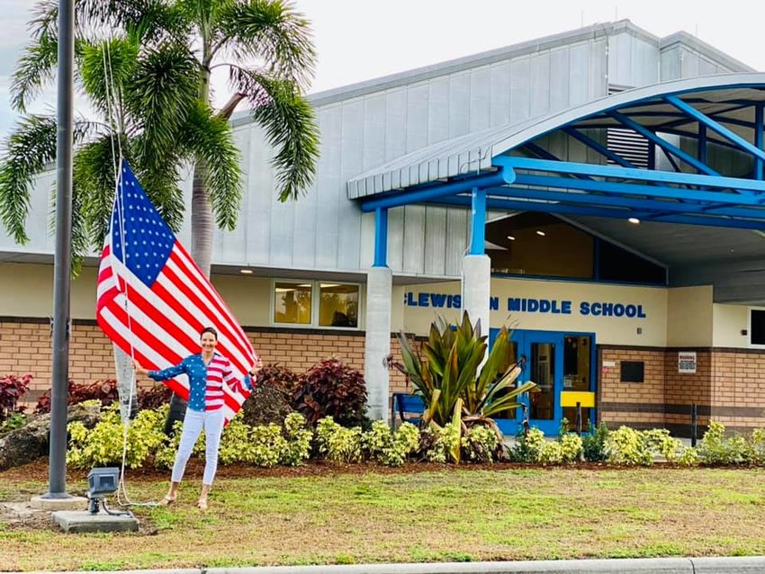 Ms.Sandra Perry, Administrative Assistant at Clewiston Middle School celebrated Flag Day, June 14, 2021 by wearing her flag shirt.