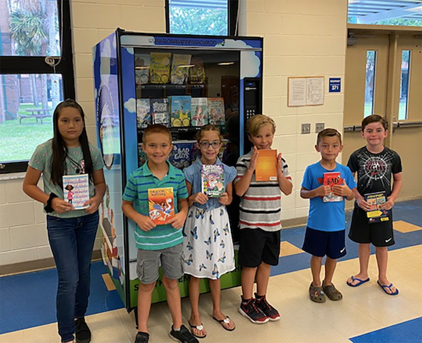 Some of South Elementary School's top readers were invited to select new books from the book vending machine on June 16.