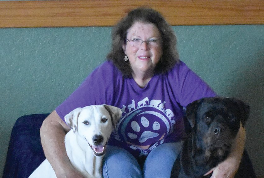 Judy Throop has two dogs of her own, Daisy Mae on the left and Ruffus on the right.