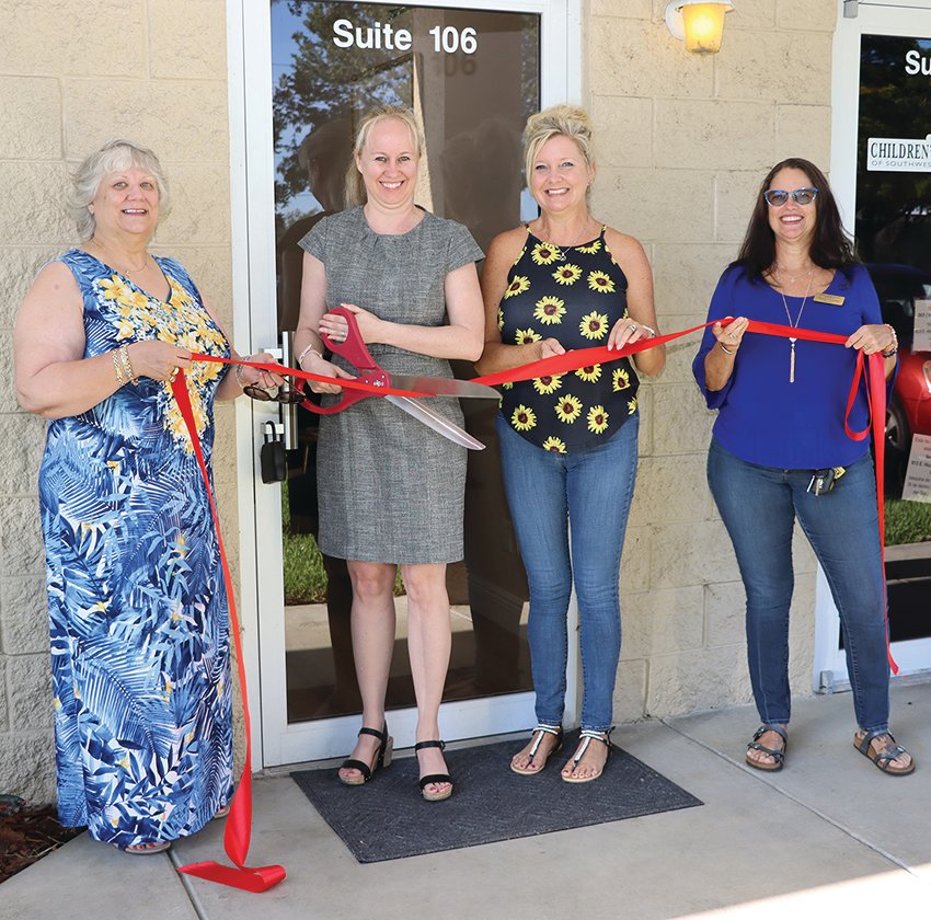 Pictured at the ribbon cutting for Beyond Barriers are from left to right Diane E Fidanza,  Executive Director LaBelle Chamber of Commerce, Charity Williams, CEO of Beyond Barriers, Amanda Nelson, President of the LaBelle Chamber of Commerce and Sherill Overberg, Vice-President of the LaBelle Chamber of Commerce.