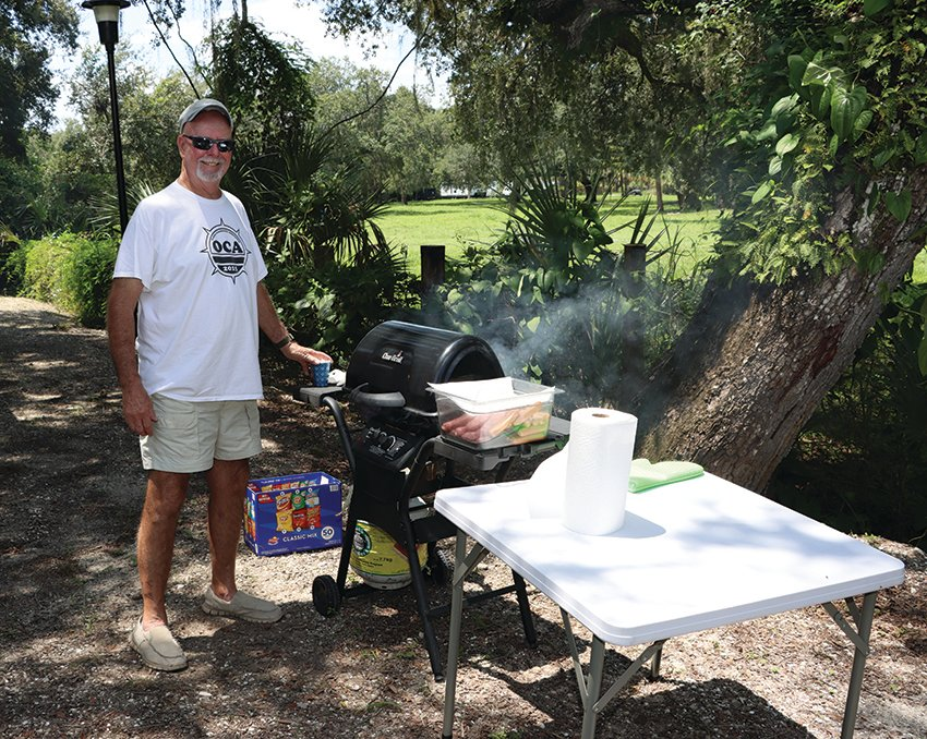 Dean Beavers was the designated cook at the OCA Ice Cream Social on Saturday, July 24, 2021.