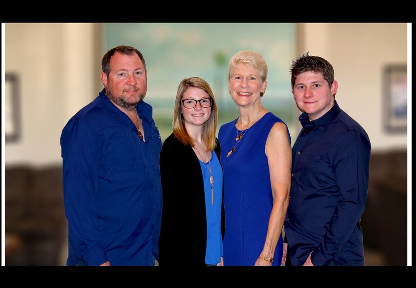 OKEECHOBEE — Pictured are three Generations of Funeral Service: Lic. Funeral Director Matthew P. Buxton, Funeral Attendant Morgan A. Buxton, Pre-need Counselor Marilyn A. Buxton, Lic. Funeral Director Philip M. Buxton.
