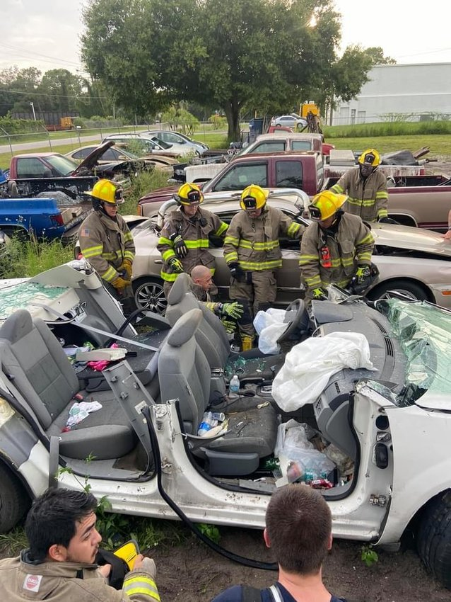 Responders participate in a hands-on extrication training at Tim's Towing and Recovery on Tuesday, September 7, 2021.