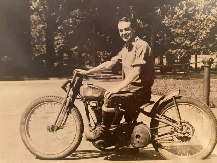 Woody riding a motorcycle, one of his favorite hobbies.
