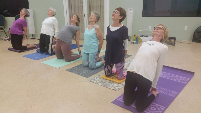 """These ladies are """"stimulating the life within"""" by practicing yoga."""