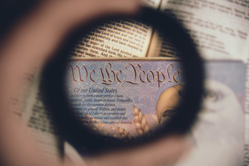 """""""We the People"""" phrase from the Constitution Preamble in focus."""