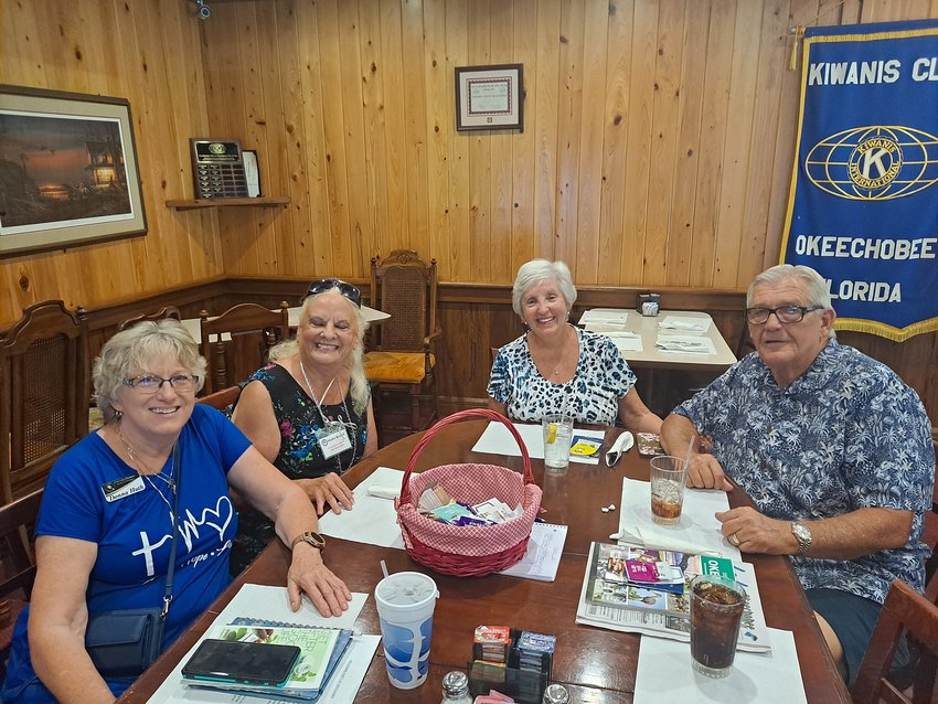 Welcoming Party Vice-chair Donna Huth (left) and Chair Helen Brumitt welcome new residents Chuck and Fran Lanham (right) to Okeechobee.