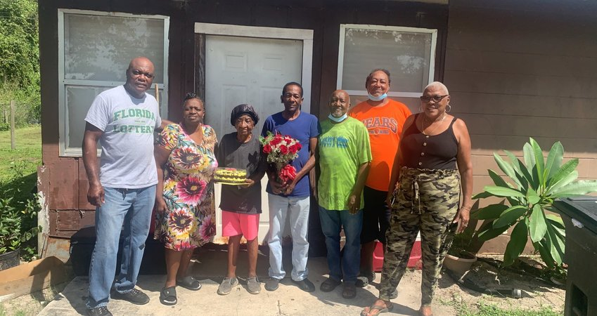 Neighbors, family, and friends gathered at Mrs. Williams's home, in the Ford-Sunset community, to celebrate her 96th birthday with a cake and flowers.