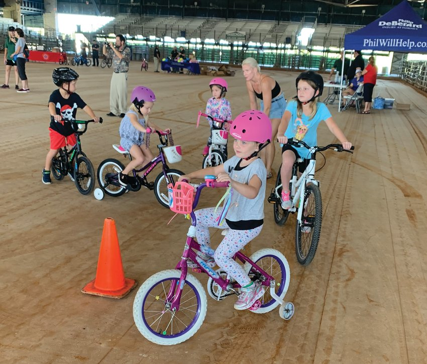 OKEECHOBEE  -- Children line up at the safety course at the bicycle rodeo, held Oct. 2 at the Okeechobee Agri-Civic Center.