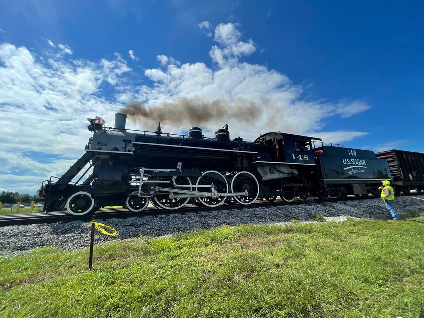 Historic Steam Engine 148 hauls sugarcane into U.S. Sugar's mill on the annual start of harvest, October 1, 2021.