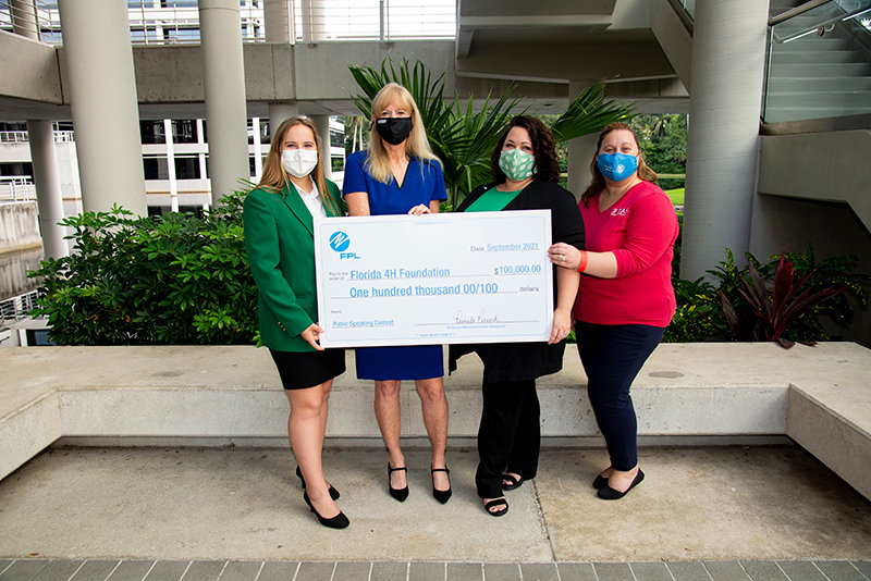 Left to right are Brooke Adams, Florida 4-H State Council officer from St. Lucie County;  Pam Rauch, vice president for external affairs and economic development at FPL;  Caylin Hilton, associate director of development for Florida 4-H;  Noelle Guay, UF/IFAS Extension Palm Beach County 4-H agent.