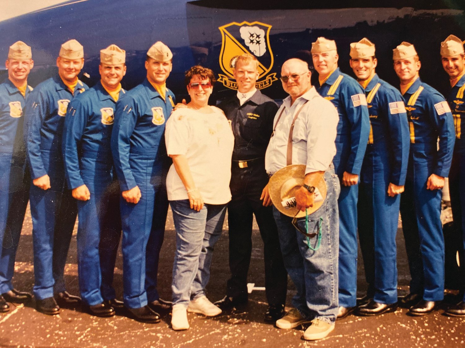 Gary Walker (center) is pictured with his Blue Angel Team (1997) and his mother, Marty Thomas, and stepfather, Glenn Thomas.