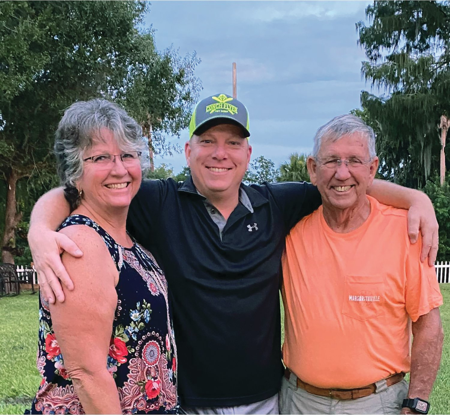 Gary Walker's father, Don Walker, and stepmother Holly Walker also live in Okeechobee and enjoy visiting with Walker (center) when he is in town.