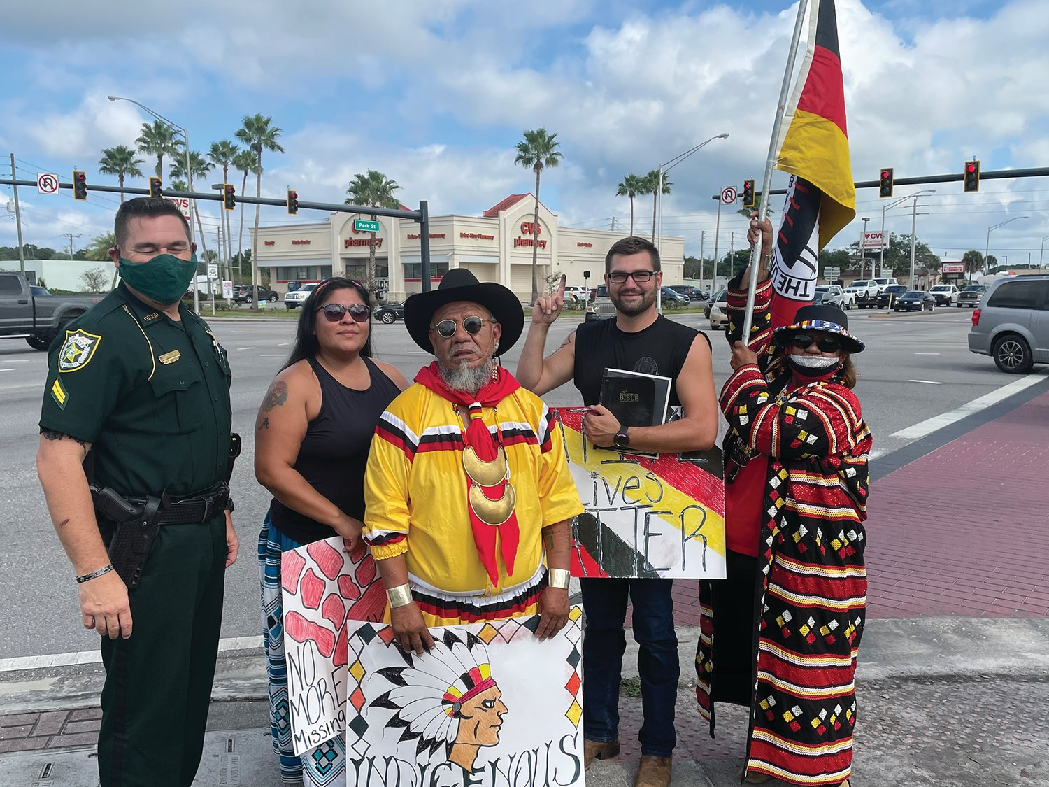 OKEECHOBEE — Native Americans observed National Native American Heritage Month with a demonstration in Flagler Park on Saturday. Okeechobee County Sheriff's Office Community Liaison Cpl. Jack Nash (left) stopped by to bring drinks to Alice Osceola, Sandy Billie and Martha Tommie. James White (center) was passing by when he noticed the demonstrators and stopped to ask how he could help.  For the story, see Page 14.