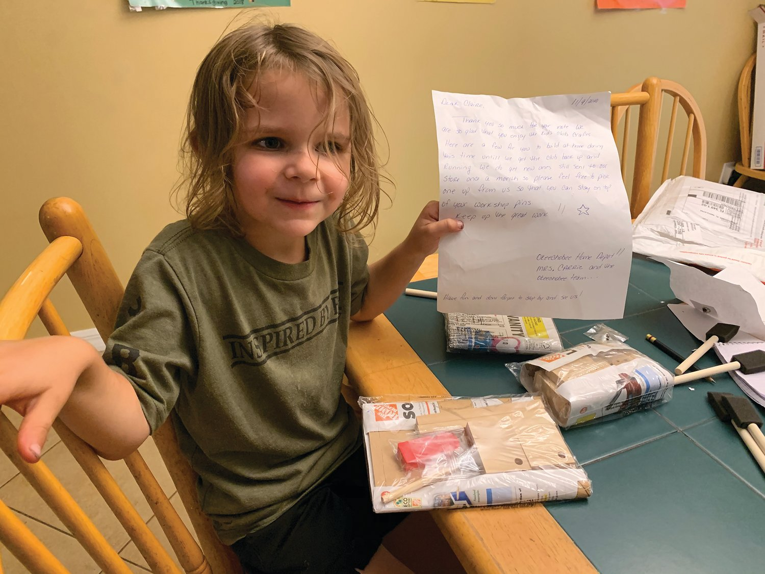 A Rock Solid Kindergarten student receives a package from Home Depot after writing to tell them she misses craft day.
