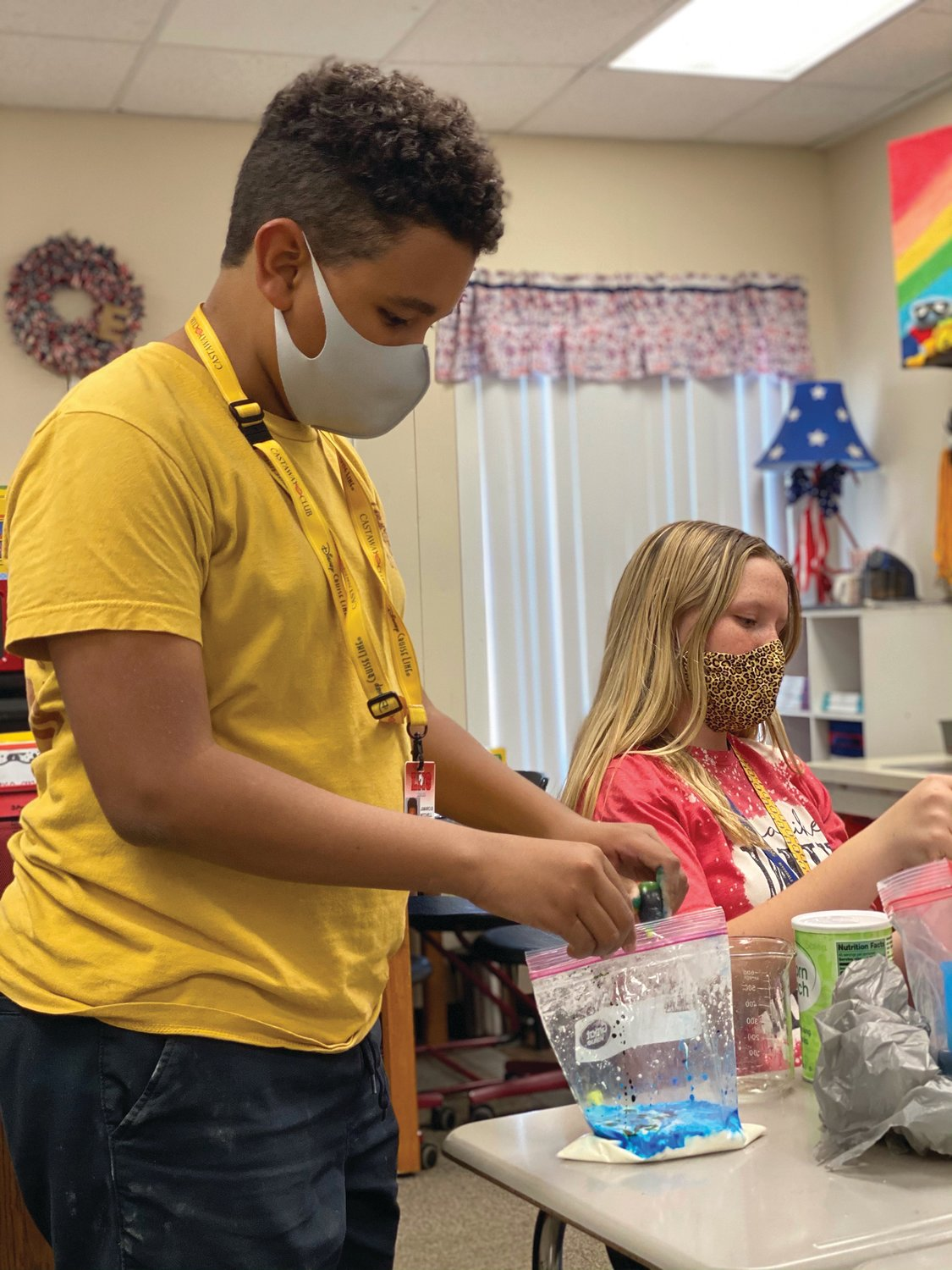 LaBelle Middle School Science Club students, Jamarcus Mitchell and Kaydence Swanson add food coloring to their Oobleck.