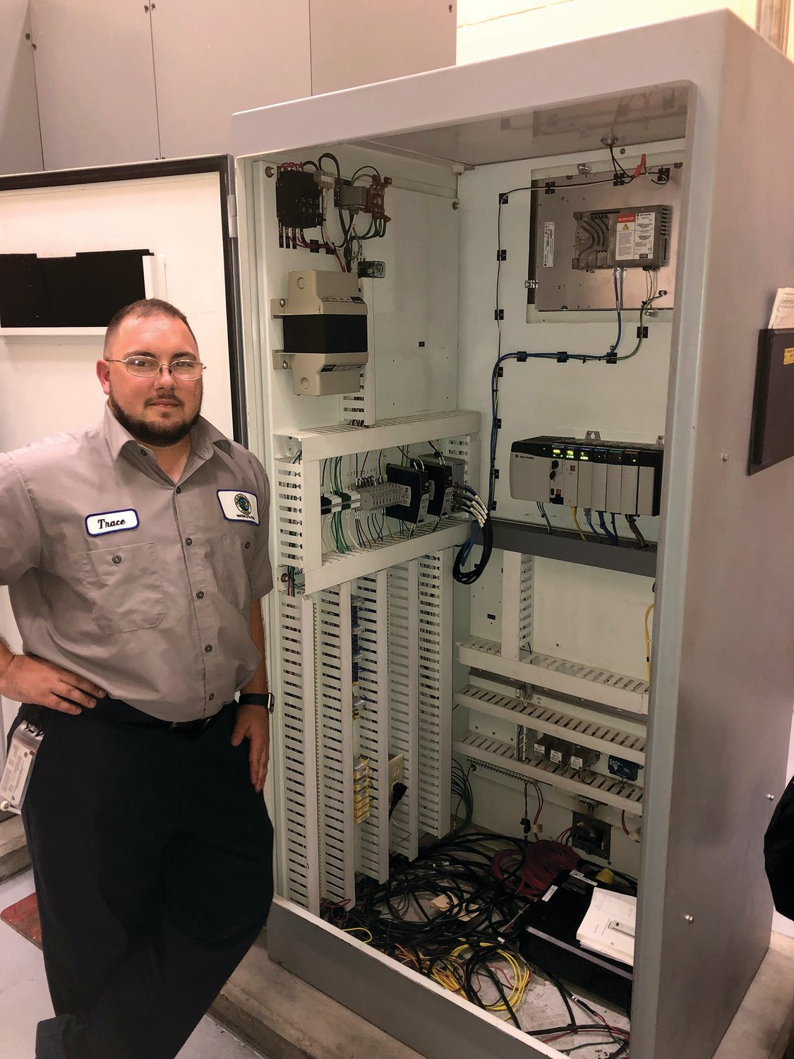 PBSC student veteran Trace Tidwell completes a cabinet rehab for a programmable logic controller (PLC) at Palm Beach County Water Utilities.