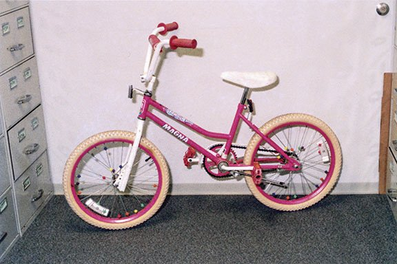 Amber's pink bicycle recovered in the parking lot where she was abducted.