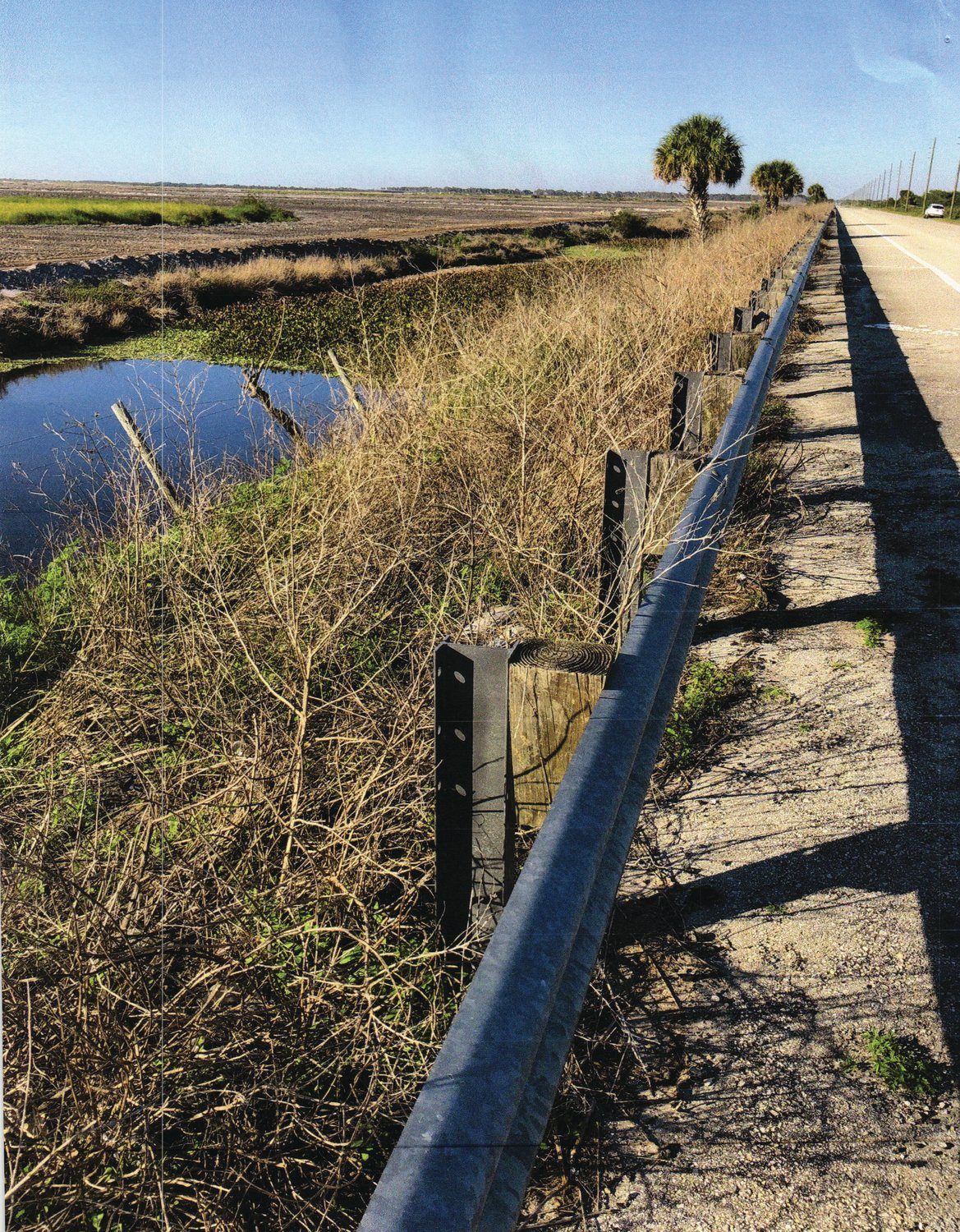 GLADES COUNTY – Drainage from Highlands County flows through ditches near County Road 721.
