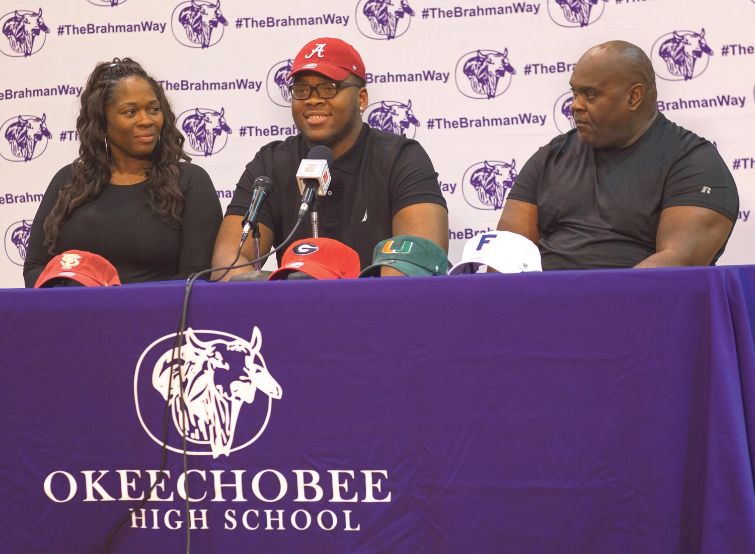 Evan Neal announced his decision in 2018 to attend the University of Alabama, as his mother and father sit by his side.