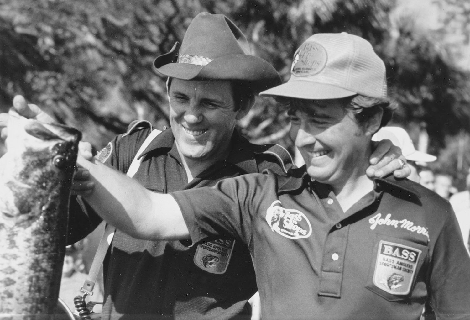 Fishing icons Ray Scott and Johnny Morris weigh in a lunker during the early days of tournament fishing.