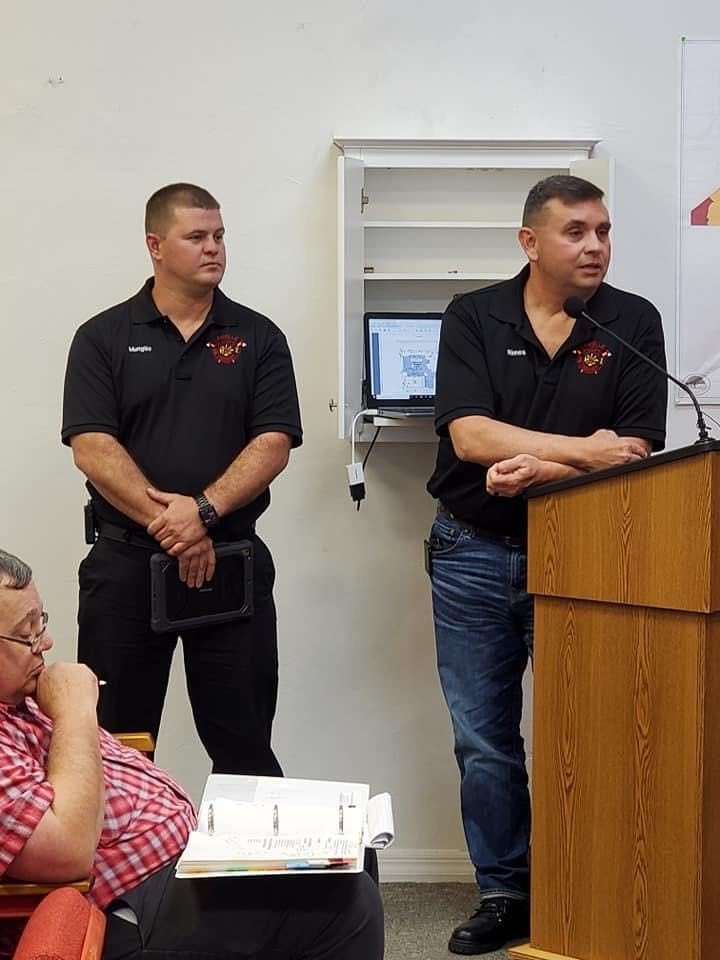 Retiring Chief Josh Rimes introduces the new Fire Chief, Micah Mungillo during the LaBelle City Commission meeting on Thursday, February 11 as Ron Zimmerly looks on.