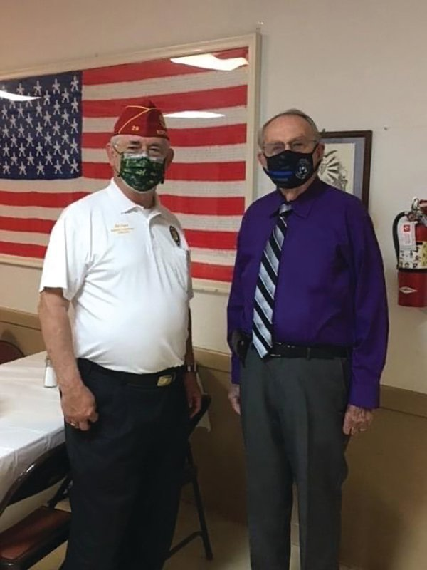"Hendry County Sheriffs Office Investigator, Don Munch, a 60 year member of the American Legion, meets with the National Commander of the American Legion, James W. ""Bill"" Oxford at LaBelle's American Legion Post."