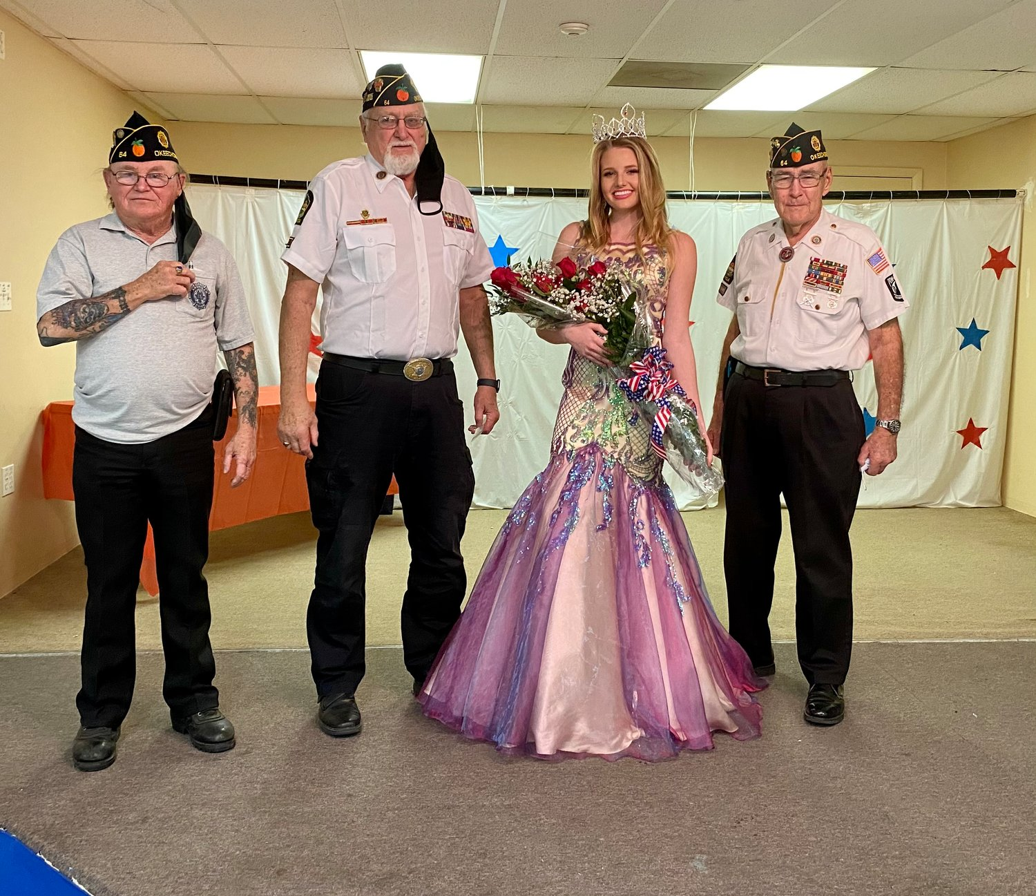 Miss American Legion 2021 Lilly Maxwell with American Legion members.