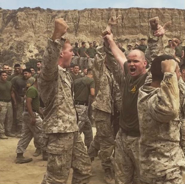 Jacob DuPree (left) and friends celebrate after taking the battalion title for hand to hand combat.