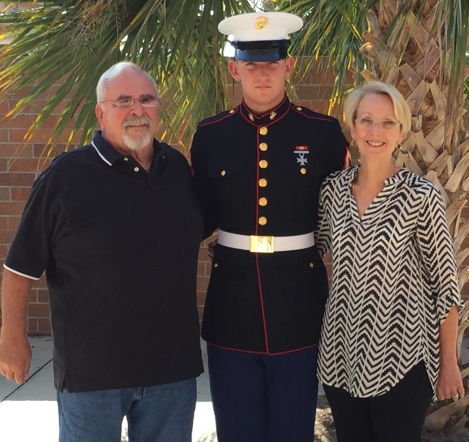 Jacob DuPree is pictured with his grandparents, Bill and Yvonne McElheny, while home on leave in 2016.