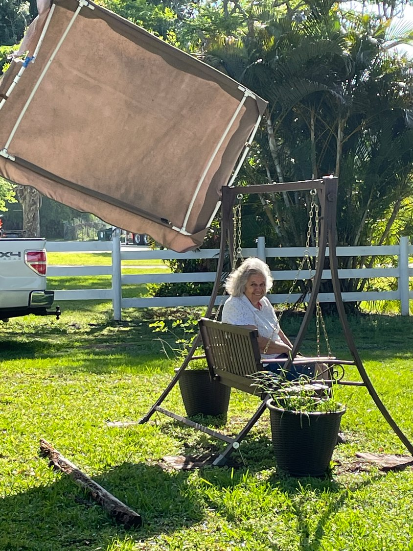 "OKEECHOBEE - Despite 19mph winds on Thursday, March 18, local woman, Kathy Womble said it was a great day. ""It's nice and cool out here."" Even having the swing canopy ripped off its frame did not phase her."