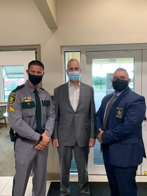 Mario Diaz-Ballart (center) met with Seargent Michael Puka and Seargent Jason Velazquez, of the Collier County Sheriff's Office while at an Immokalee Chamber meet and greet.
