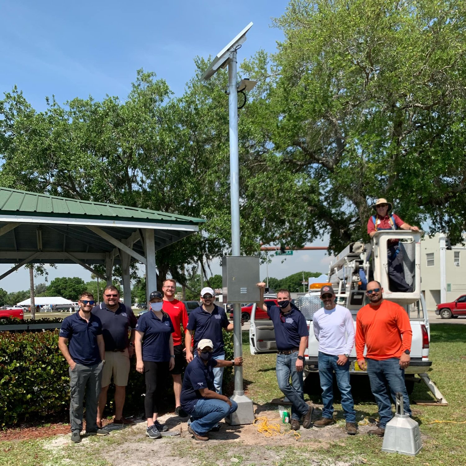The city of Okeechobee and the Florida Engineering Leadership Institute class of 2020/21 install hotspot towers in city parks.