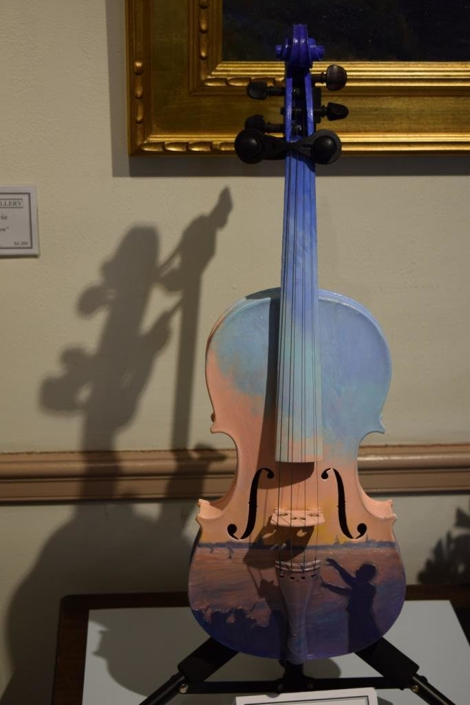Melissa Gryder, an Arnold resident, painted the view of the sunset from Jonas Green Park on her violin.
