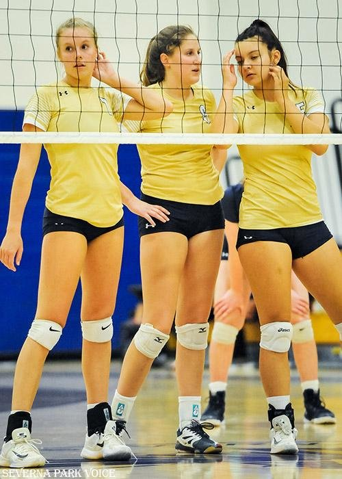(L-R) Georgia Marriner, Ally Fletcher and Chloe Campbell got ready to defend the net in the Severna Park volleyball team's matchup with Howard on September 25.