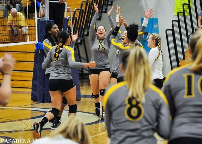 The Northeast varsity volleyball team celebrated match point in its win over Chesapeake on the first day of school on September 4.