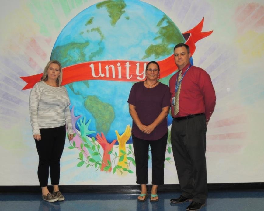 Chesapeake cluster parents Amy Panzer and Erin Shawbell spent their summer vacation painting the floor-to-ceiling unity mural in the main hallway at the request of CHS principal Stephen Gorski.