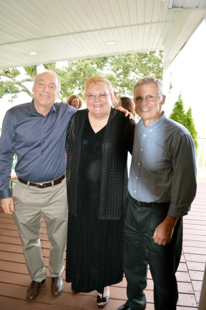Loraine Dailey celebrated her retirement during a recent party at Celebrations at the Bay. She was joined by many friends and former colleagues including Steve Hittman (left) and Neil Padgett.