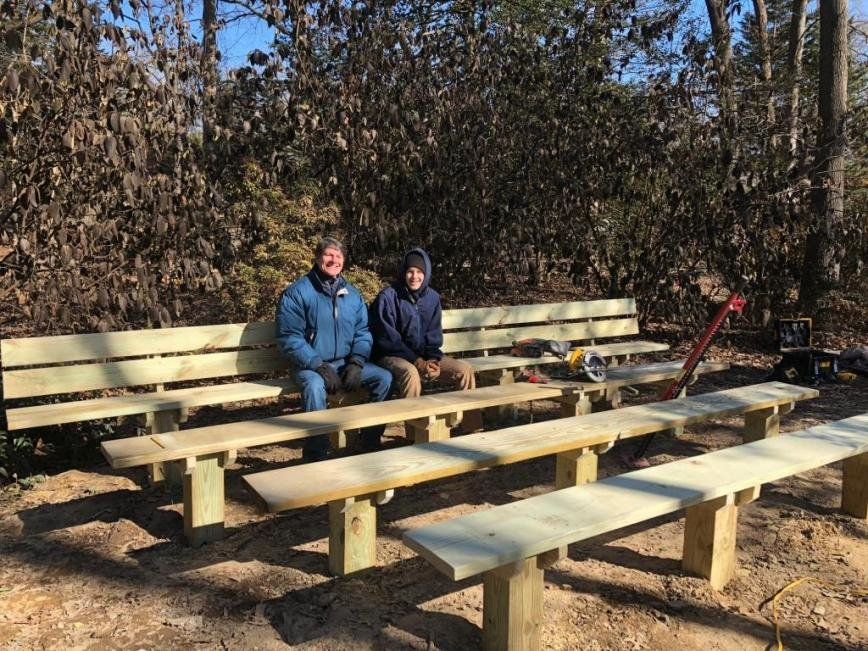 Erick Howard (right), seen here with SPUMC facilities manager Dave McKinney, recently led an effort to design, purchase and assemble benches on the church grounds as part of his Eagle Scout project.