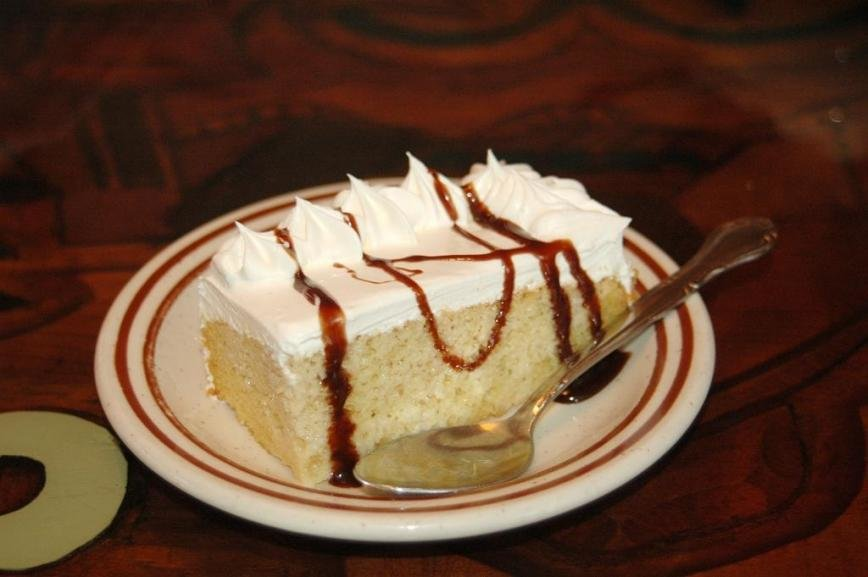 The tres leches white cake, topped with a nice layer of icing, was soft and sweet.