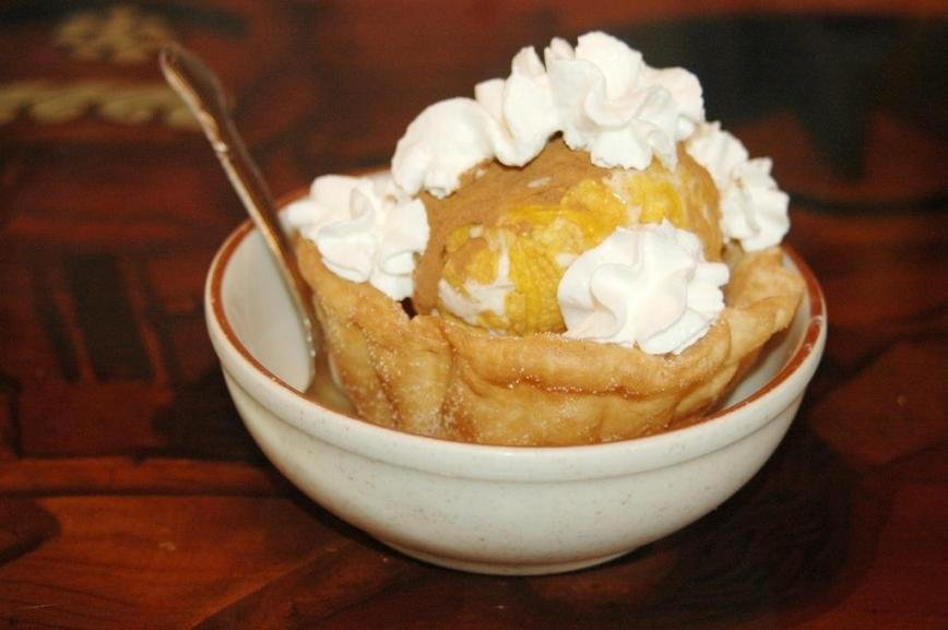 The fried ice cream was topped with honey, sprinkled with cinnamon and served in a baked shell.