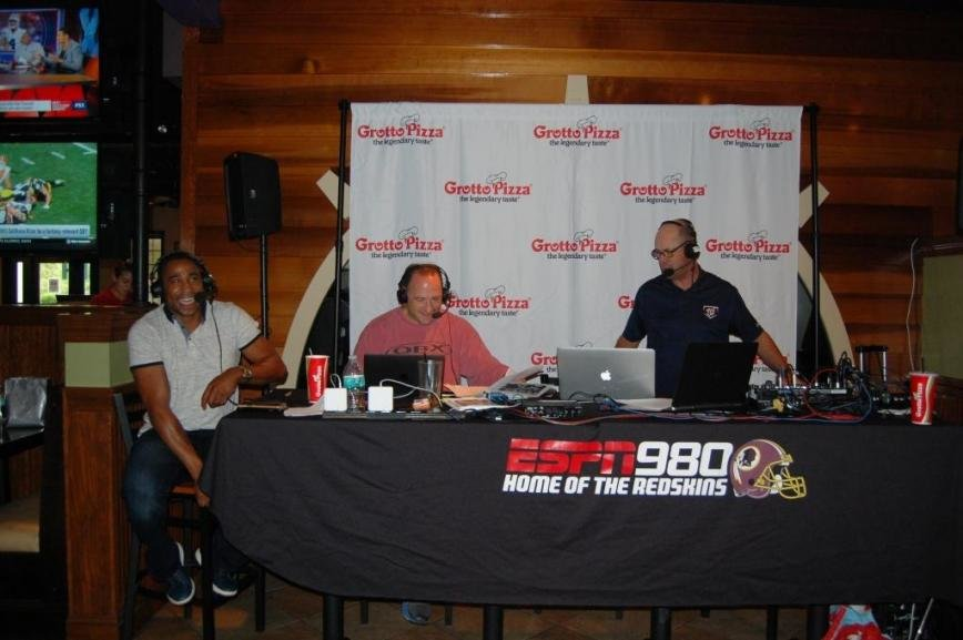 "Former Washington Redskin Fred Smoot with Scott Linn and Steve Czaban of ESPN 980, broadcasting, ""The Steve Czaban Show."""