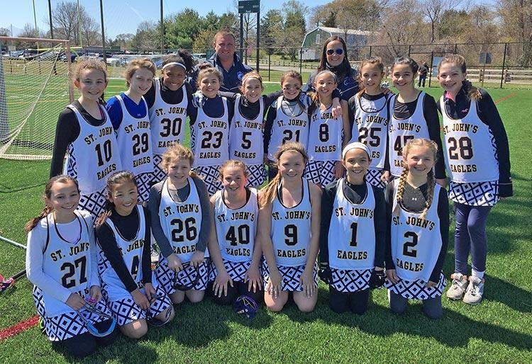 St. John the Evangelist's sixth-grade girls lacrosse team went 5-3-1 and made the playoffs in the county's Middie A division.