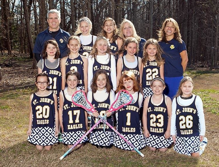 St. John the Evangelist's third-grade girls lacrosse team enjoyed a season of development and teamwork as the program continues to field competitive teams despite the school's small student population.