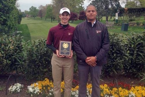 Severn's Eric Hall with coach Chris Haskins following Hall's record two-day score of 135 won him the MIAA championship.