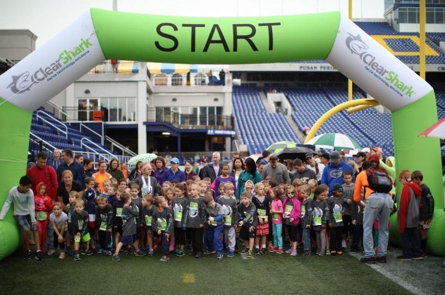 Kids 12 and under gathered at the start line at Navy-Marine Corps Memorial Stadium on Saturday morning to participate in the Shark Sprint.